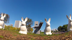White Rabbit Statues & Pedestrian Bridge- Newport Beach CA Stock Footage
