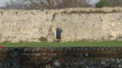 Portchester Castle side entrance with old Roman Walls built about 250 AD Stock Footage