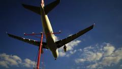 Large Passenger Jet Flying Overhead on Landing Approach Stock Footage