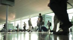 Stock Video Footage of Passengers with luggage in the airport