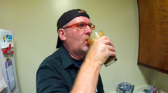 Mature Man Drinks Juice Made From Home Juicer Stock Footage