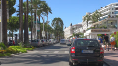 Traffic car street croisette boulevard cannes france carlton hotel palm tree day Stock Footage