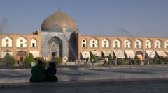 Young Iranian couple looks out over Imam Square in Isfahan Stock Footage