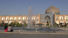 Iranian couple looks at fountain show in romantic Isfahan, Iran Stock Footage