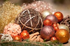 glittering christmas decoration in orange and brown natural wood - stock photo