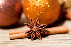 Anice cinnamon and bauble christmas decoration in gold Stock Photos