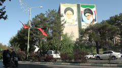 Murals of Iran's current and former Supreme Leader portrayed on building - stock footage