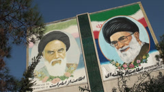 Iran Supreme Leader picture painting wall Khomeini Khamenei propaganda Stock Footage