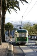 Stock Photo of streetcar in san francisco with the foggy twin peaks in the background