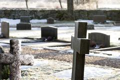tombstones on winter day - stock photo