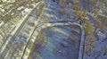 Flight over  frozen lake in  winter city. Aerial HD Footage