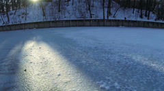 The frozen lake and sundeams . Aerial - stock footage