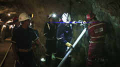 Miners and technicians working in mine Stock Footage