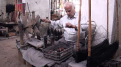 Iran, carpet weaving, man collecting thread, wages, poverty - stock footage
