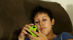 Attractive bored woman playing on her cellphone Stock Footage