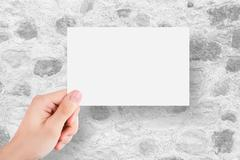 Stock Photo of hand holding blank board