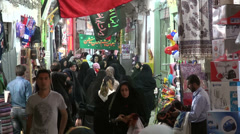 Iran, busy bazaar, crowded, people, women wearing chadors Stock Footage