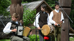 Young musicians boys play folk music with accordion and drum Stock Footage