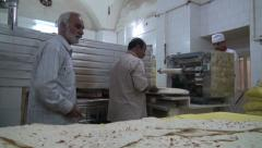 Iran, men prepare fresh bread in bakery Stock Footage