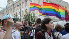 People flags in Gay Pride parade march to support equality right Stock Footage