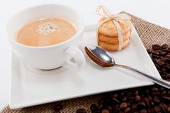 Fresh aromatic coffee and cookies on table Stock Photos