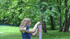 Woman clip pin laundry towel clothesline and cat walk in grass Stock Footage