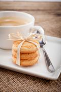 fresh aromatic coffee and cookies on table - stock photo