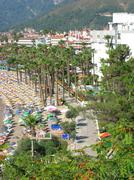 Beach landscape sun-tents ans sun-beds Stock Photos