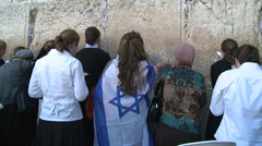 Woman at the western wall Stock Footage