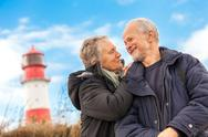 Stock Photo of happy mature couple relaxing baltic sea dunes