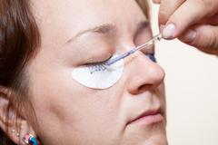eyelash dyeing with permanent makeup - stock photo