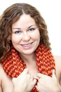 head and shoulders portrait of young smiling curly haired woman with scarf on - stock photo