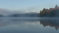 TIME LAPSE - Mist Rolling over Lake in Morning Stock Footage