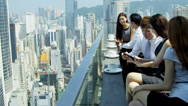 Stock Video Footage of Young Asian Chinese Share Brokers Tablet Office Rooftop