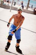 Young man with inline skates in summer outdoor Stock Photos