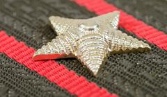 star on the shoulder strap of russian army officer close up - stock photo