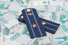 Shoulder strap of russian army on money  background Stock Photos