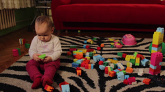 Cute Baby Sitting and  Playing With Toys In A Room Stock Footage