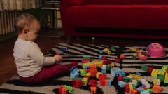 Baby Sitting and  Playing With Toys In A Room - stock footage