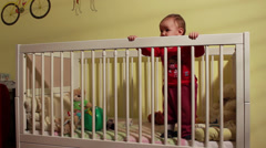 Beautiful Baby Standing In Crib,Medium Shot. Stock Footage