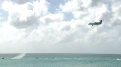 Wide shot of Plane Landing On St. Maarten Island Stock Footage