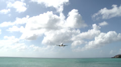 Long Shot of a Plane Flying Directly Overhead in Caribbean Stock Footage