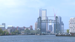 Movable bridge in Rotterdam in front of skyscrappers Stock Footage