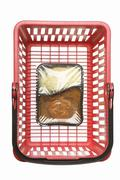 Stock Photo of Shopping basket with convenience food, studio shot