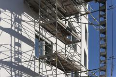 Germany, Bavaria, Munich, scaffold at facade of apartment tower Stock Photos