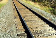 Stock Photo of Empty train tracks receding