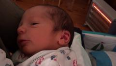 Winding a newborn Stock Footage