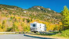 Recreational Vehicles Driving Past Grandfather Mountain on Blue Ridge Parkway - stock footage
