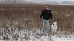 Man with a dog in the field Stock Footage