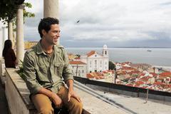 Stock Photo of Portugal, Lisboa, Alfama, Miradouro de Santa Luzia, young man enjoying vista